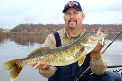 Paul Earney and 28-inch walleye